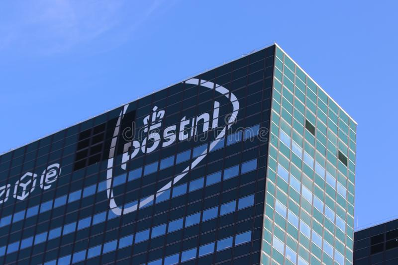 Logo of the PostNL on the head office in The Hague in the Netherlands. royalty free stock image