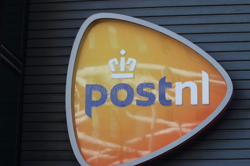 Logo of the PostNL on the head office in The Hague in the Netherlands. royalty free stock photography