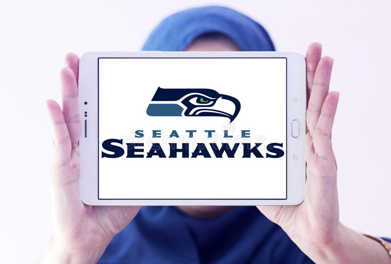 Seattle Seahawks american football team logo. Logo of Seattle Seahawks american football team on samsung tablet holded by arab muslim woman. The Seattle Seahawks stock photography