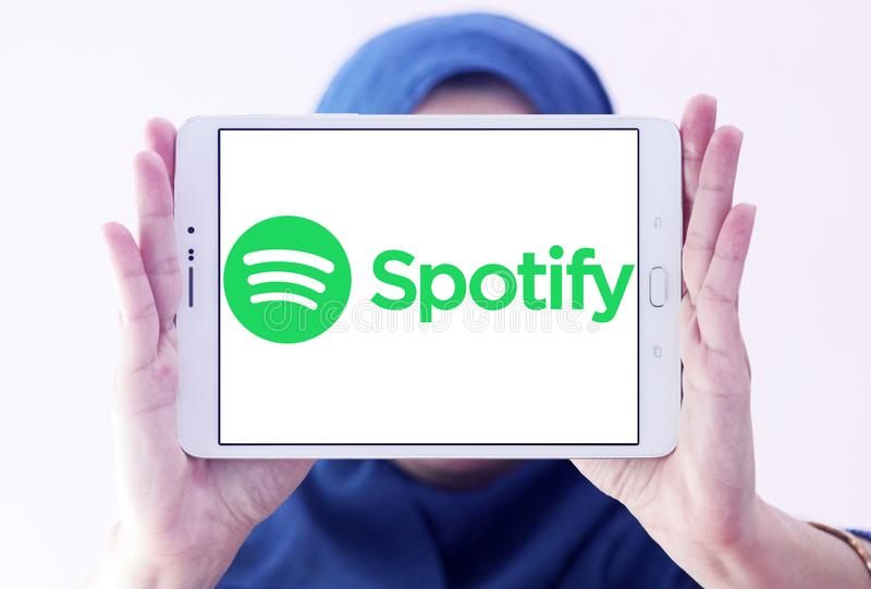 Spotify logo. Logo of Spotify on samsung tablet holded by arab muslim woman. Spotify is a music, podcast, and video streaming service royalty free stock photography