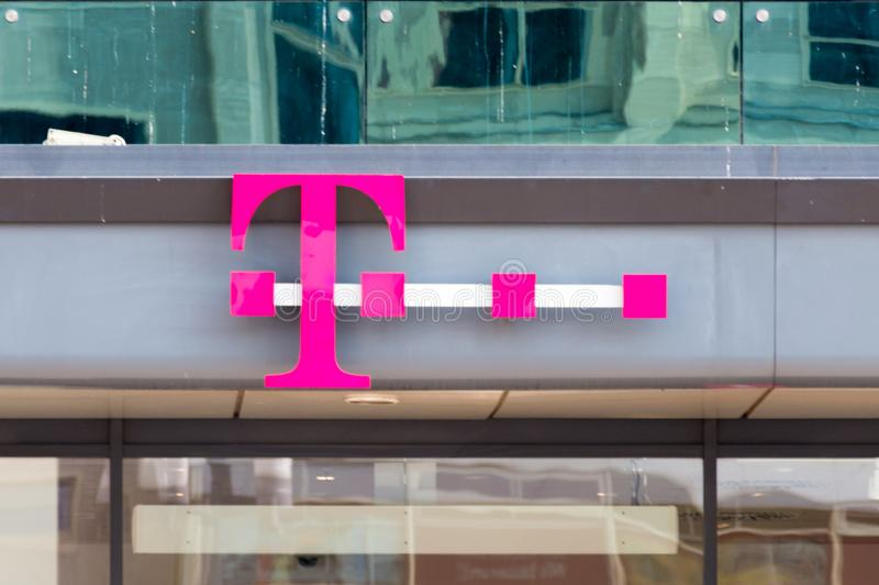 Logo of T-Mobile on the store in Berlin. stock photography