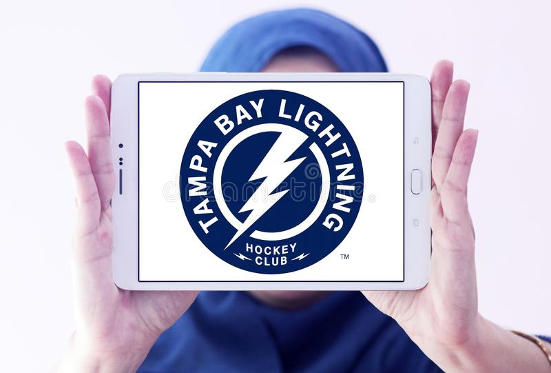 Tampa Bay Lightning ice hockey team logo. Logo of Tampa Bay Lightning club on samsung tablet holded by arab muslim woman. The Tampa Bay Lightning are a stock images