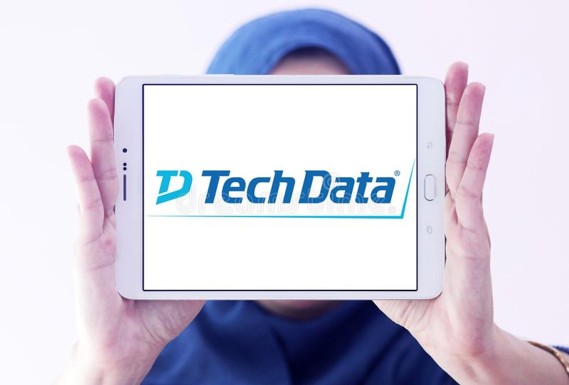 Tech Data company logo. Logo of Tech Data company on samsung tablet holded by arab muslim woman. Tech Data is an American multinational distribution company stock photography