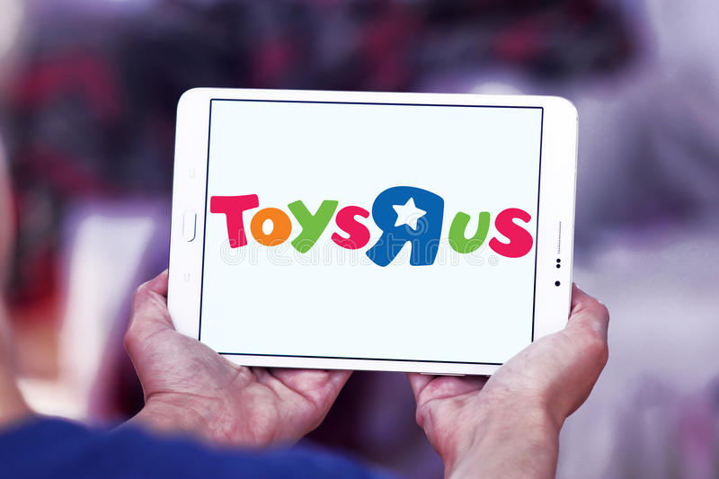 Toys R Us kids store logo. Logo of Toys R Us kids store on samsung tablet. Toys `R` Us, Inc. is an American toy and juvenile-products retailer. it is the leading stock photo