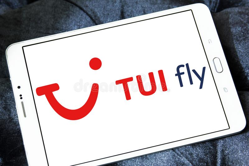 TUI fly logo. Logo of TUI fly on samsung tablet royalty free stock photo