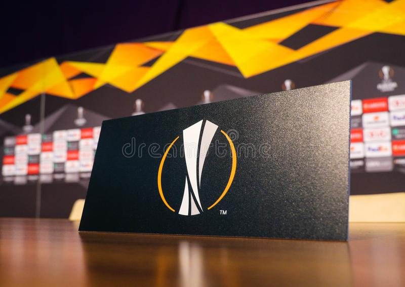Logo of the UEFA Europa League. POLTAVA, UKRAINE - OCTOBER 3, 2018: Logo of the UEFA Europa League on the plate during a pre-match press conference on the eve of stock photos
