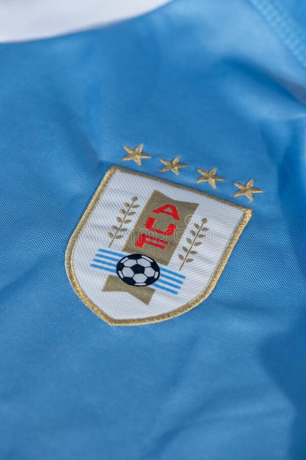 Logo of Uruguay football national team federation printed on shirt, AUF Asociacion Uruguaya de. Canillo , Andorra - 9 abril 2020 - Logo of Uruguay football royalty free stock photos
