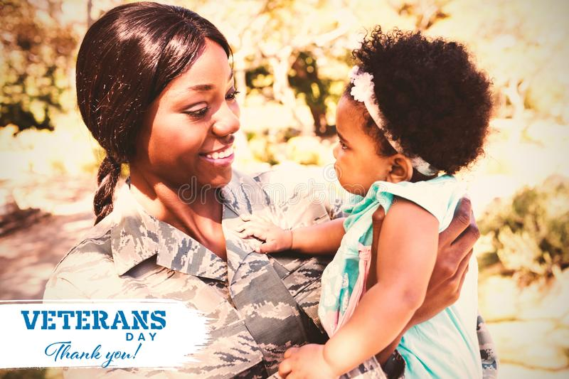Composite image of logo for veterans day in america. Logo for veterans day in america against close up of mother carrying daughter at park royalty free stock images
