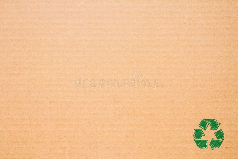 Logoen återanvänder på brunt papper arkivbild