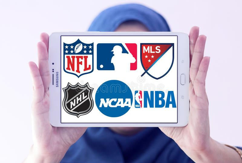 Usa sports logos and icons. Logos and icons of most popular usa sports leagues on samsung tablet holded by arab muslim woman. leagues like nfl, mls, nba, nhl royalty free stock photography