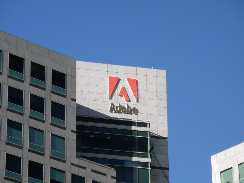 Logotipo de Adobe a un lado de la construcción imagen de archivo