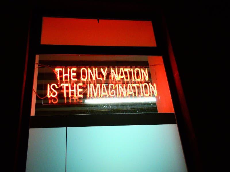 Logotipo: La ?nica naci?n es la imaginaci?n fotografía de archivo