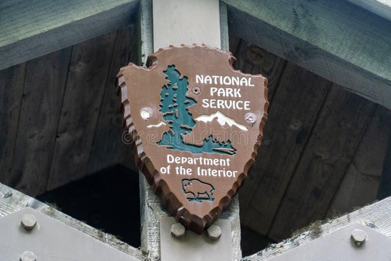 Logotipo para o cargo de sinal de National Park Service do Estados Unidos imagem de stock royalty free