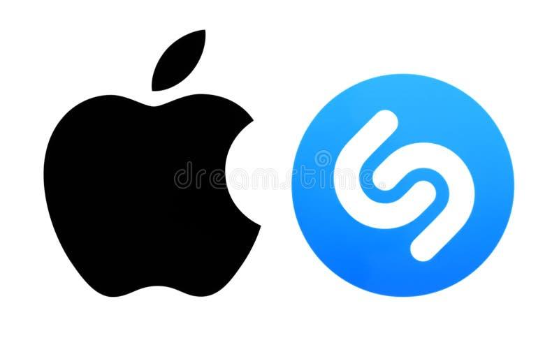 Logotipos populares de la marca impresos en el papel: IOS de Apple y Shazam fotografía de archivo