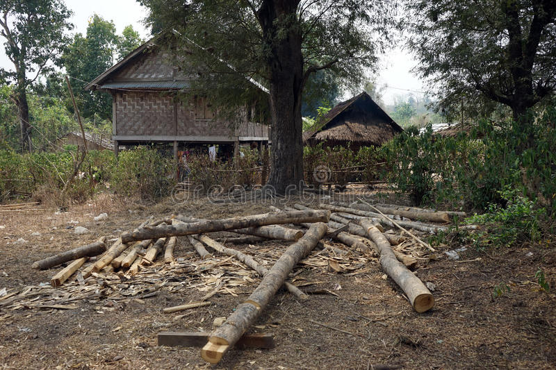 Logs and bamboo houses. In burmese village stock images