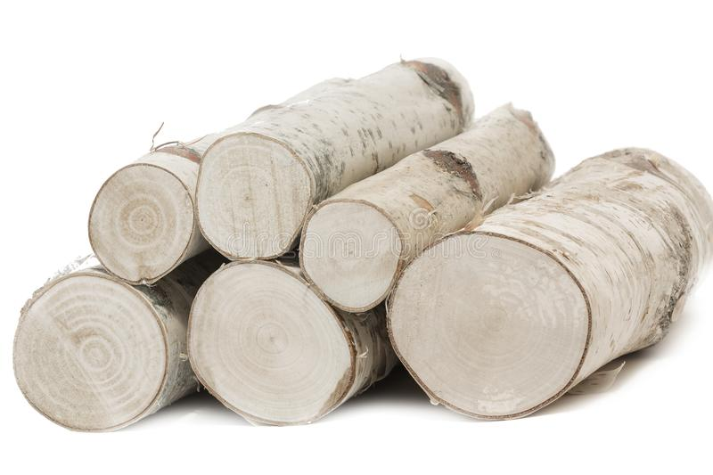 Logs of birch wood on white background stock photos