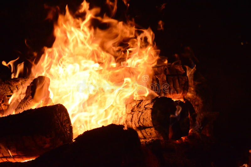 Logs Burning in a Fire Pit stock images