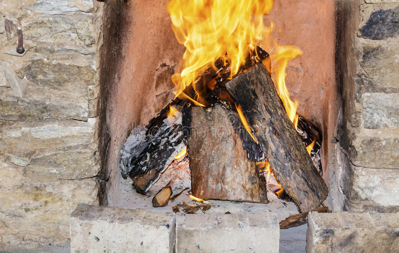 Logs Burning in a fireplace royalty free stock image