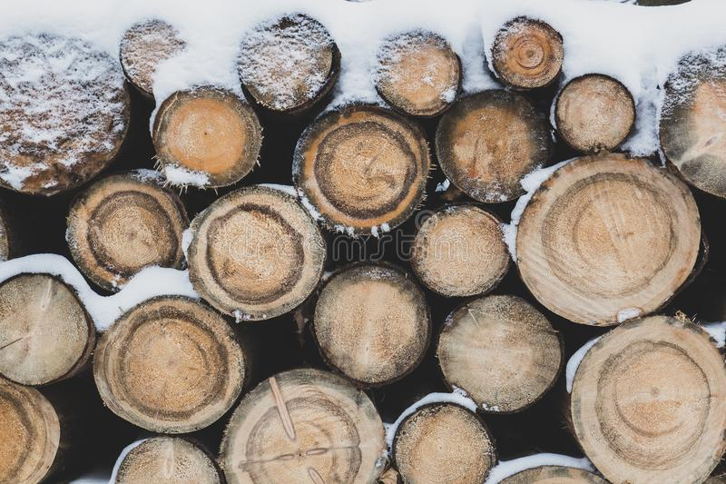 The logs are dusted with snow stock images