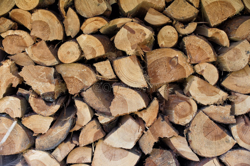 Logs or piles of firewood royalty free stock image