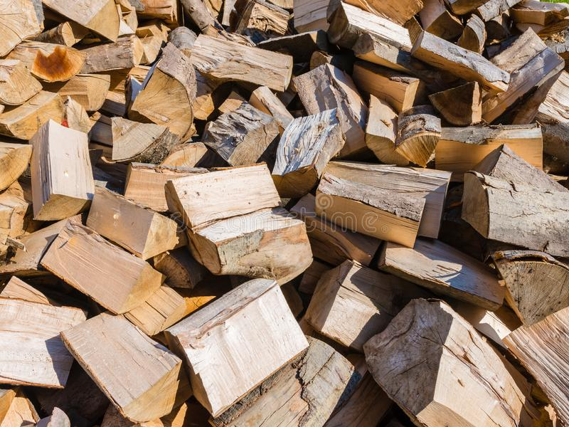 The logs of wood - cut wood - thrown on the pile. The logs of wood - cut wood - loosely thrown on the pile royalty free stock photos