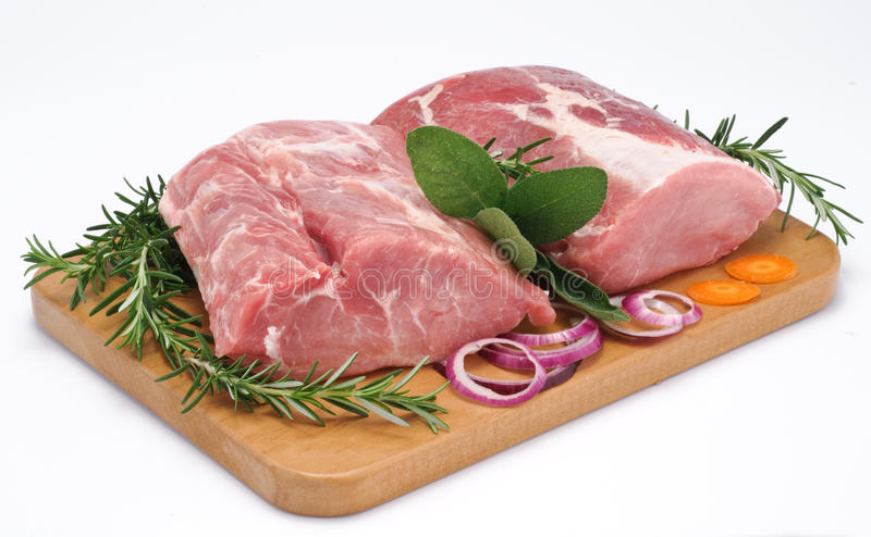 Loin of pork. Pork on wooden board stock image