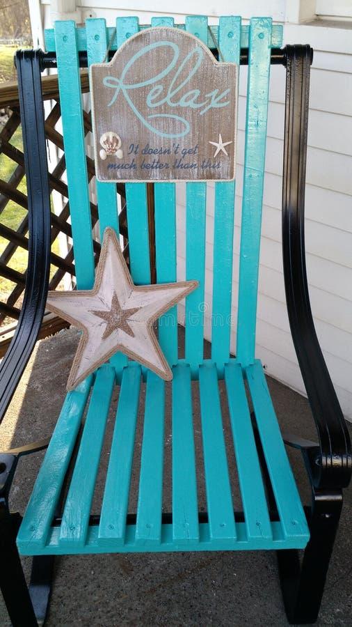 lokaliserad semesterortsjösida för strand stol royaltyfri bild