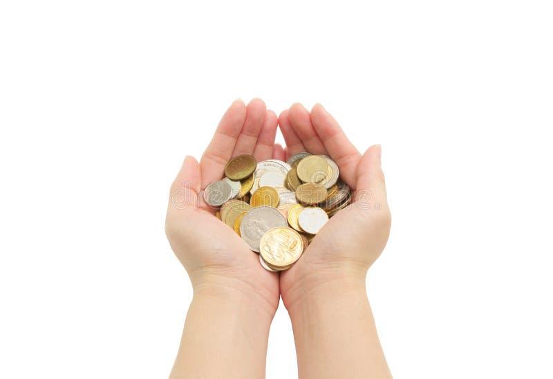 Lokalisiert von den Händen der Frau, die Münzen halten lizenzfreies stockbild