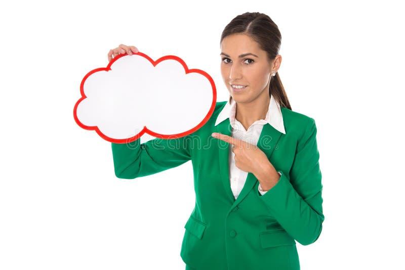Lokalisierte Geschäftsfrau im grünem Zeigen auf ein weißes Schild stockbilder