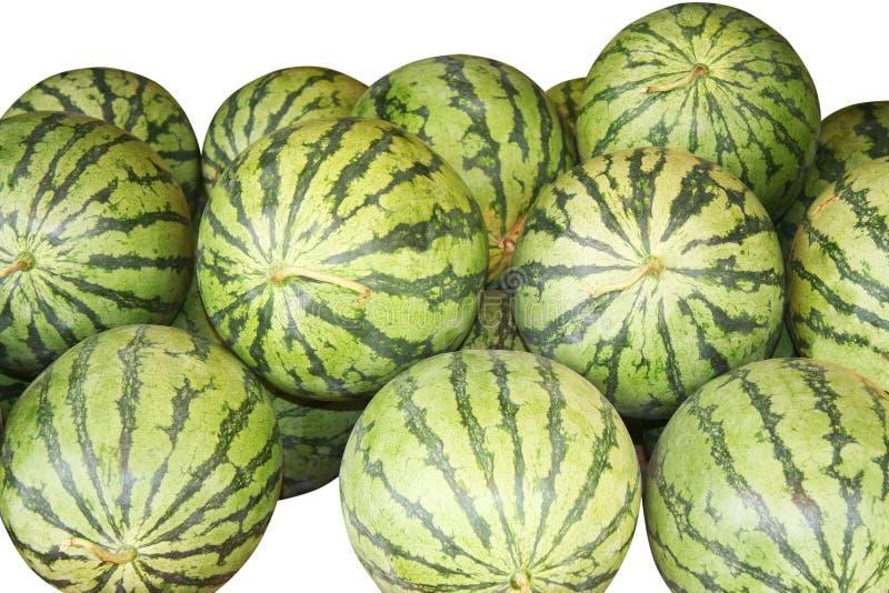 Lokalisierte Stapelwassermelonen auf weißem Hintergrund stockfoto