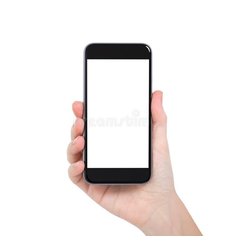 Lokalisierte weibliche Hand, die ein Telefon mit weißem Schirm hält stockfoto