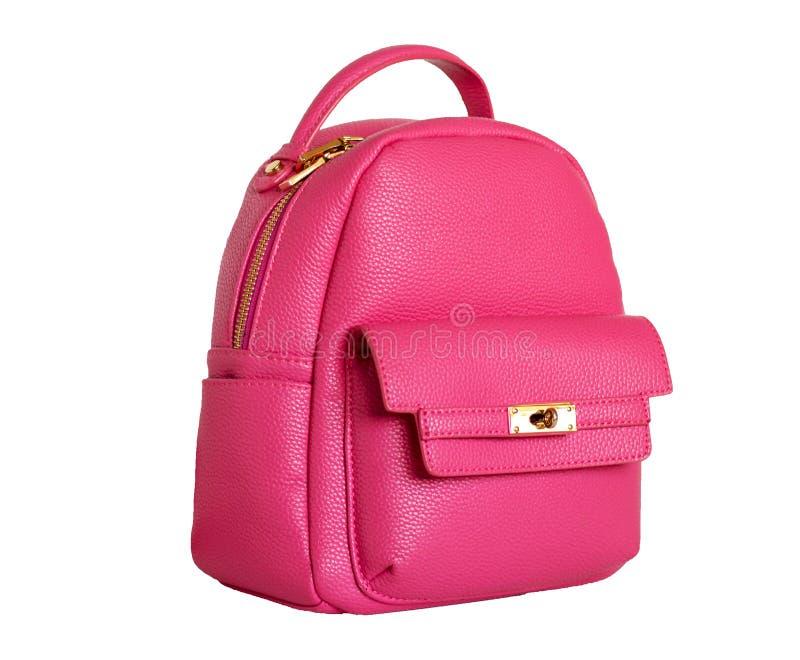lokalisierter rosa Rucksack mit Zubehörgoldfarbe stockfotos