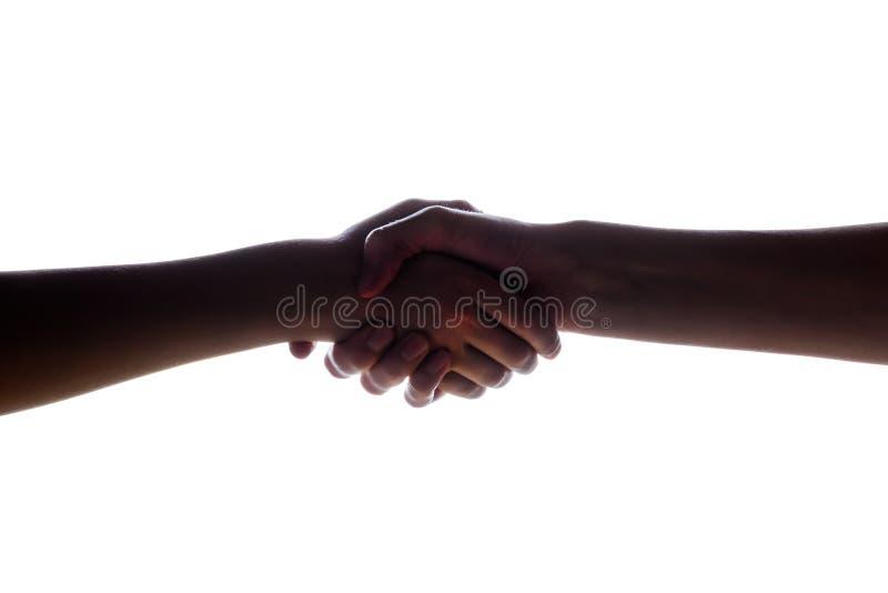Lokalisiertes Bild eines Händedrucks und der Mutter und des Sohns, der Frau und des Jungen Das Konzept der Familie, Unterstützung stockbilder