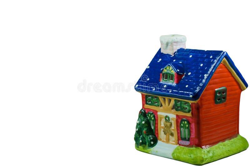 Lokalisiertes Lehm Weihnachtshaus lizenzfreie stockfotografie