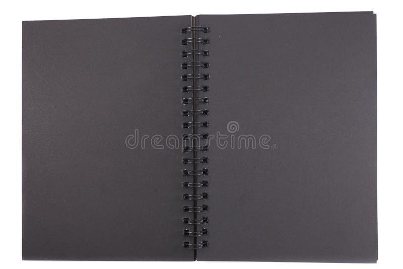 Lokalisiertes schwarzes Abdeckungsnotizbuch auf weißem Hintergrund mit Kopie spac lizenzfreie stockfotografie