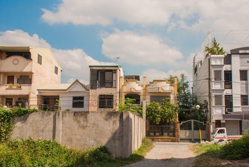 Lokalna ulica z domami w Filipińskim kapitałowym Manila zdjęcia royalty free