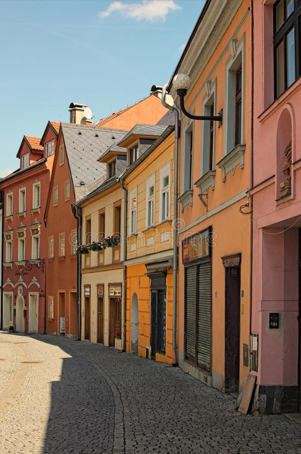 The historical street of medieval Loket with colorful buildings and cobblestone road by summer day royalty free stock photos
