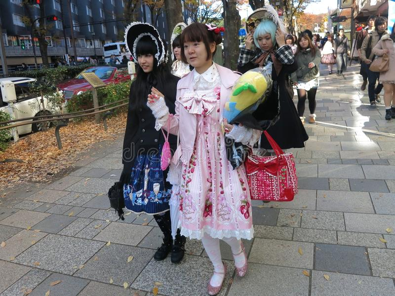 Lolita Fashion Girls Walking Down the Street. Lolita fashion girls walk down a public street in Japan royalty free stock images