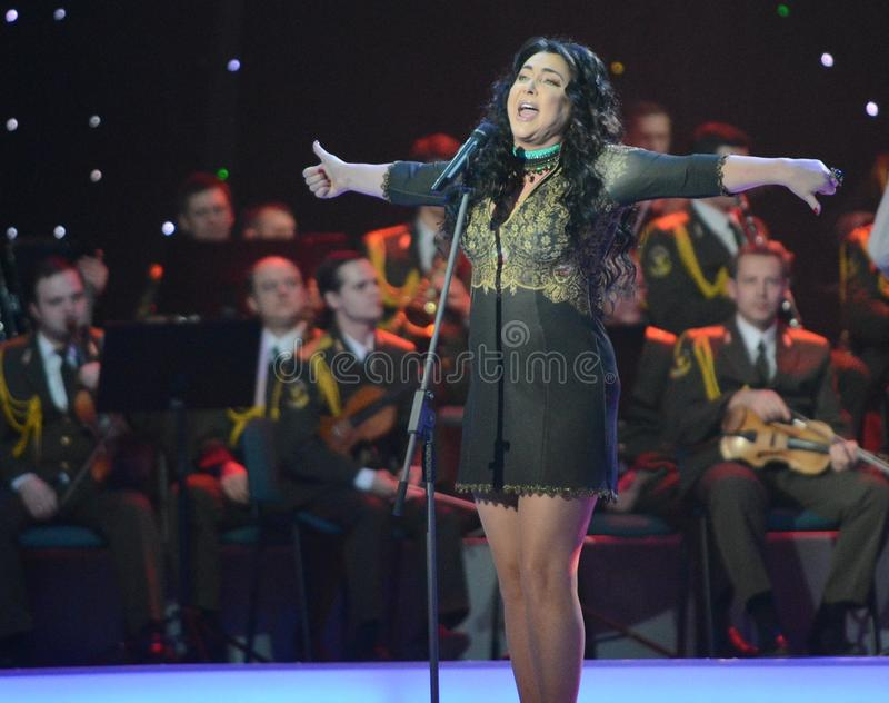 Lolita. MOSCOW, RUSSIA - FEBRUARY 27, 2014: Lolita - Russian singer, actress, TV presenter and Director. Concert in the State Kremlin Palace ceremony Shield and stock image