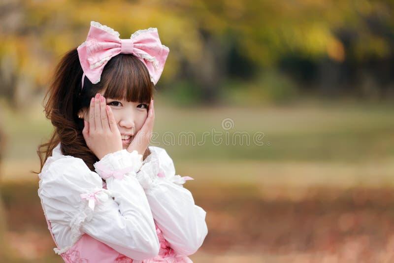 Lolita portrait. Japanese in sweet lolita cosplay in harajuku park, Tokyo stock images