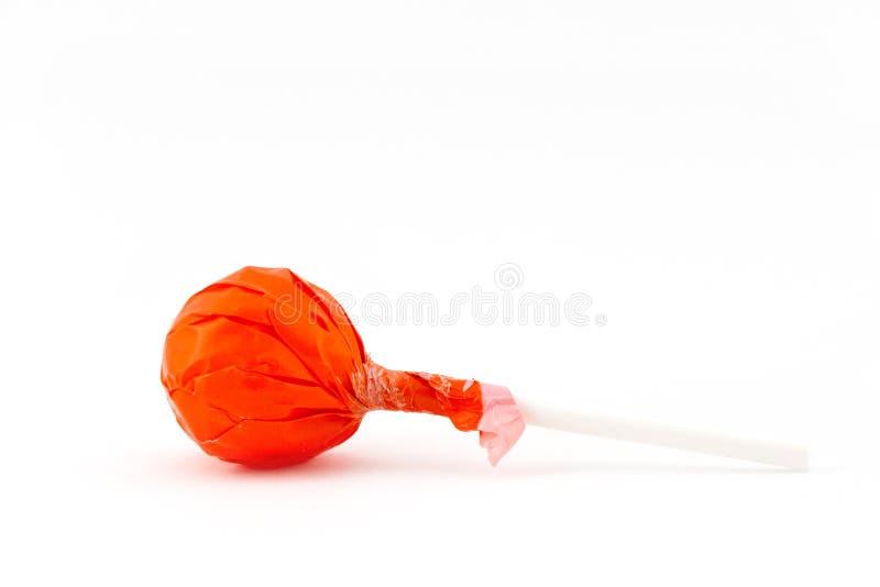 Lollipop alaranjado fotografia de stock royalty free