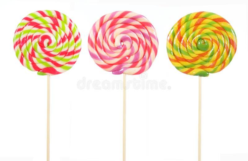 Lollipop colorido da forma redonda do estilo retro isolado foto de stock