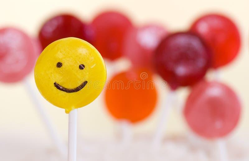 Lollipop feliz da face fotografia de stock royalty free