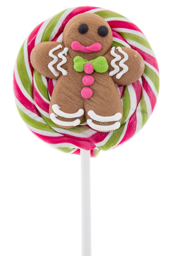 Lollipop with gingerbread man. Christmas lollipop with gingerbread man, isolated on white background stock photo