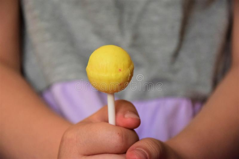 Lollipop in the hands of a child royalty free stock photography