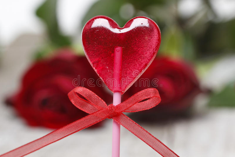 Lollipop in heart shape royalty free stock image