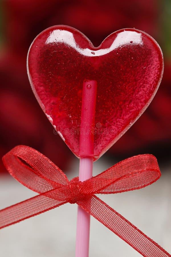 Lollipop in heart shape royalty free stock photography