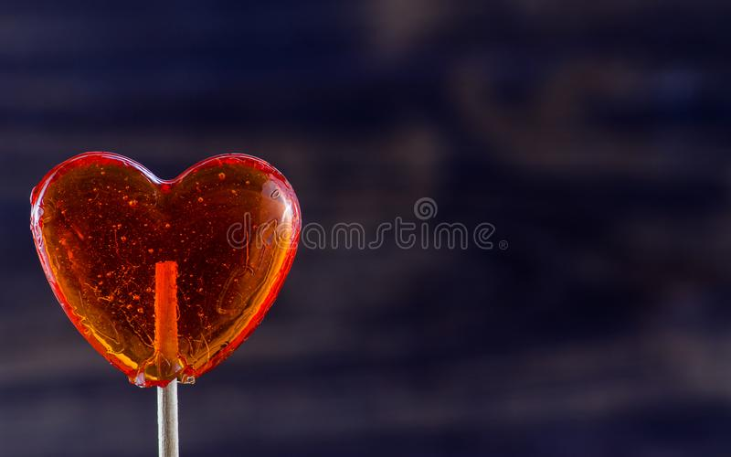 Lollipop in shape of heart royalty free stock image