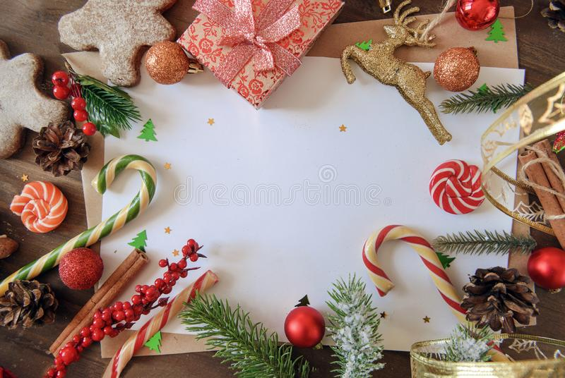 lollipops, gift box , sweets, fir branches, around white blank sheet for inscription royalty free stock photo