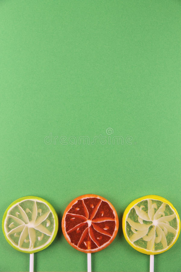 Lollipops on a green background royalty free stock image
